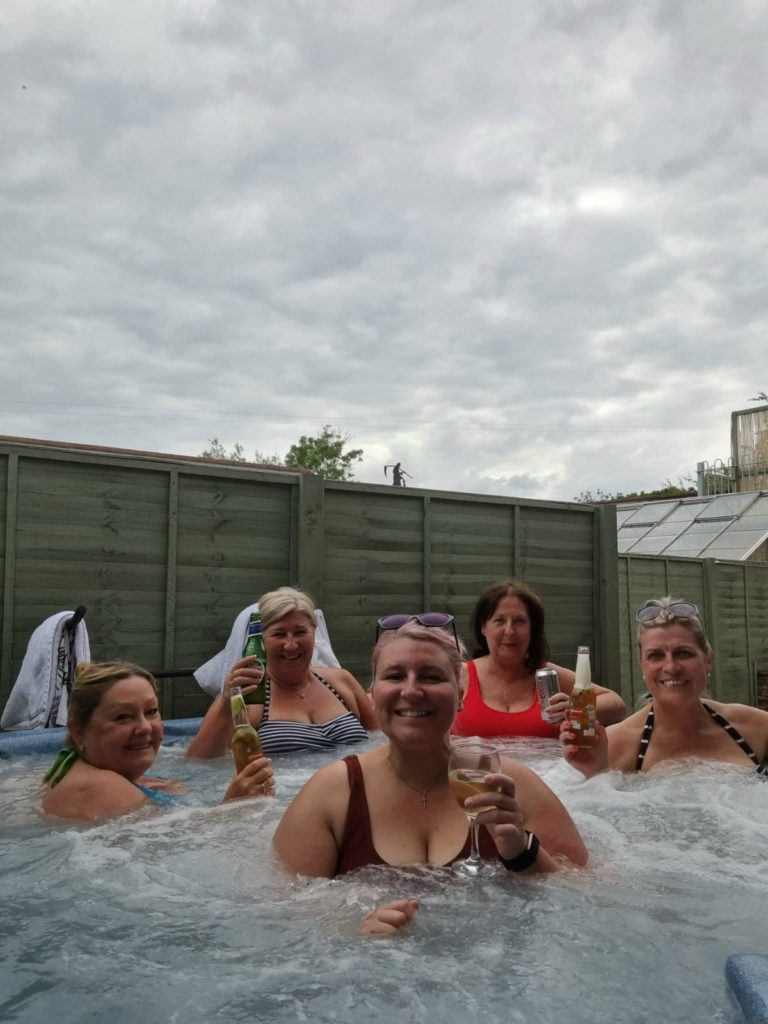 Lorri and the gang celebrating the Scotland win in style in the hot tub